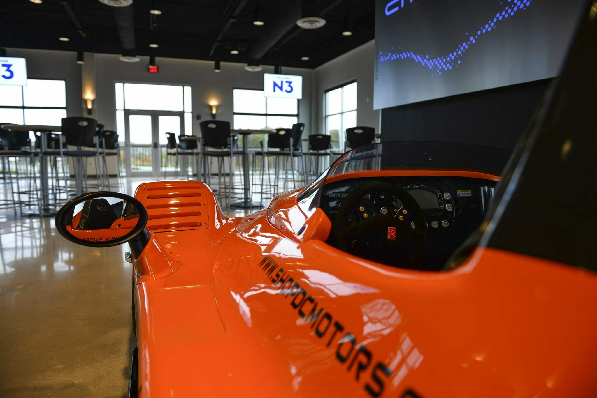 Venue with Orange Car